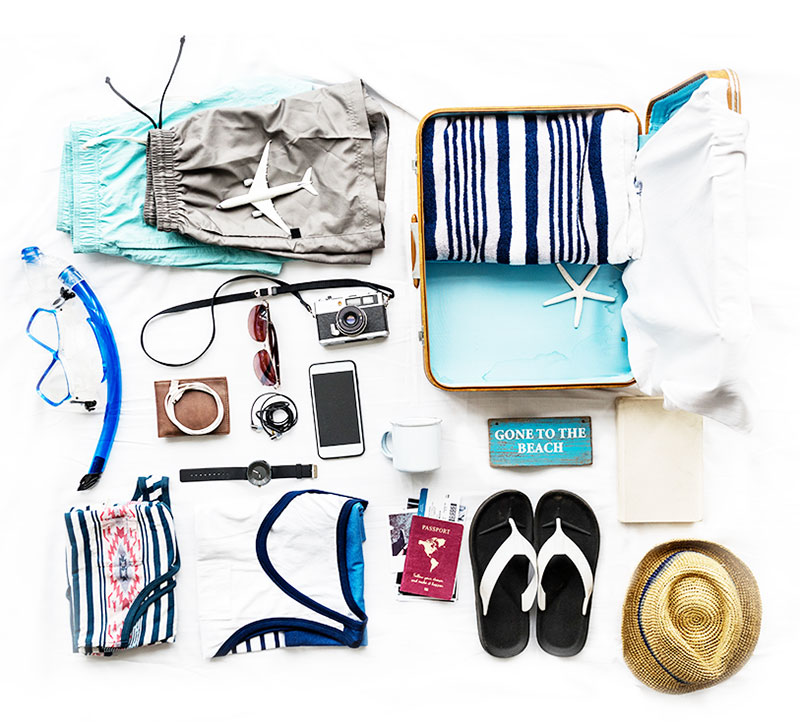Random items laid out to be packed in a suitcase
